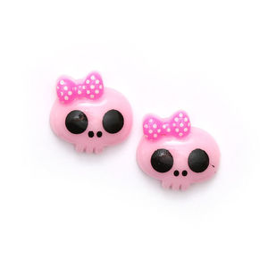 Light pink baby doll skull with bow clip-on earrings