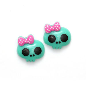 Green baby doll skull with bow clip-on earrings